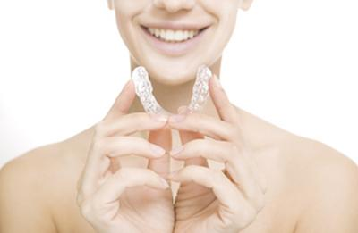 Woman holding a MouthGuard | Booragoon Dentist