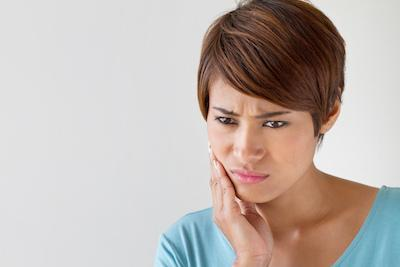 Woman with jaw pain | Extractions Booragoon